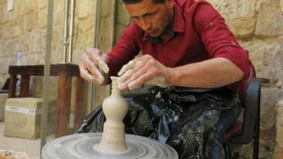 Mostafa is showing us how to use the potter wheel