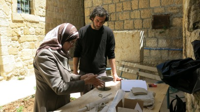 Faten is showing an ancient method of using clay